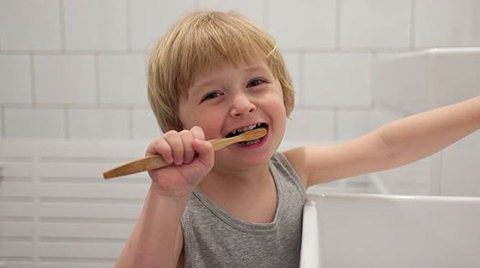 Child using a Smiles for the People Toothbrush