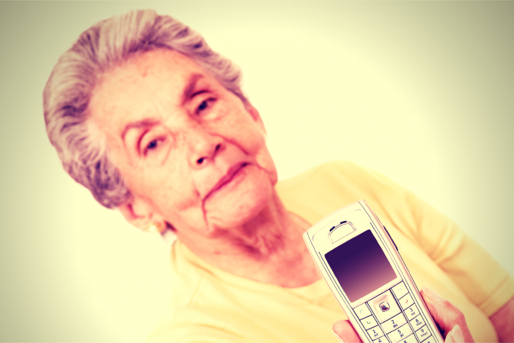 Granny holding out mobile phone