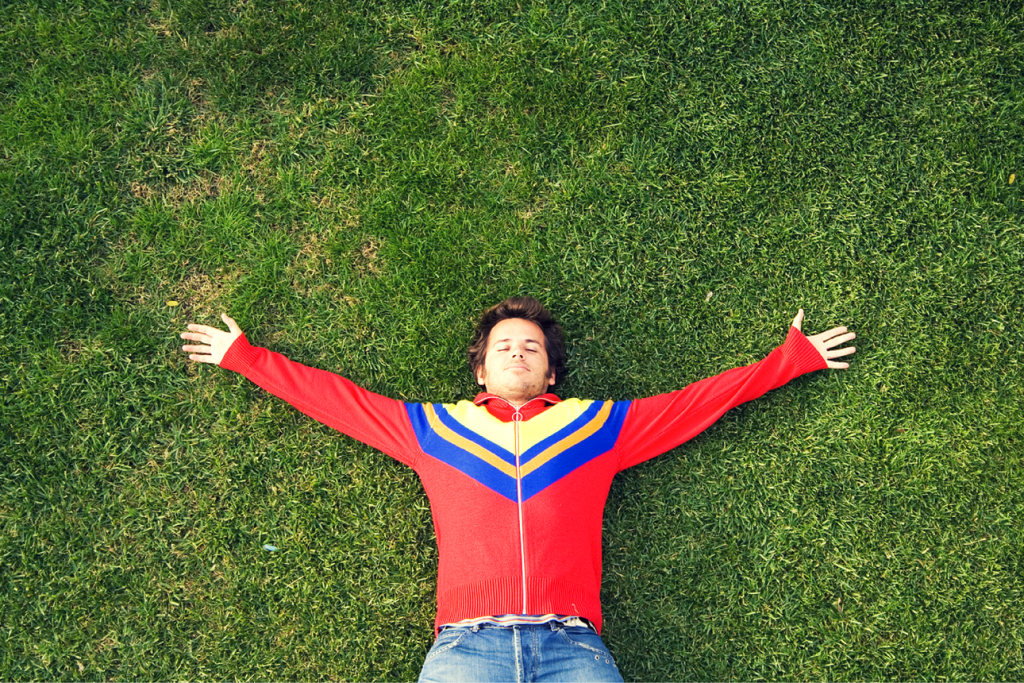 Man lying happily on grass