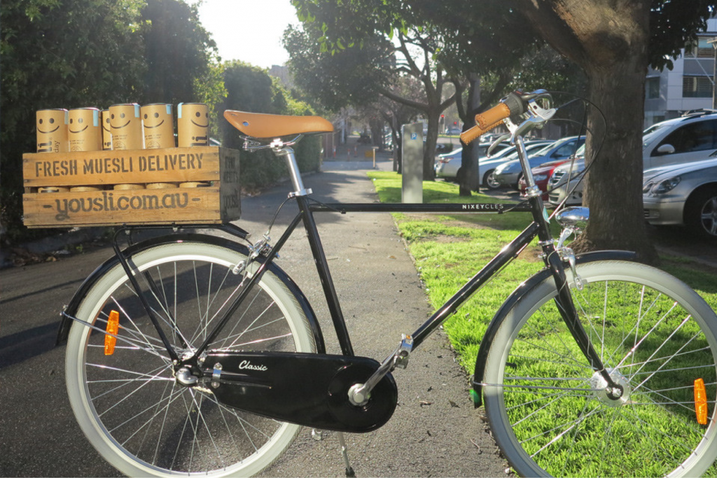 A cruiser bike with a french basket for delivering Yousli muesli