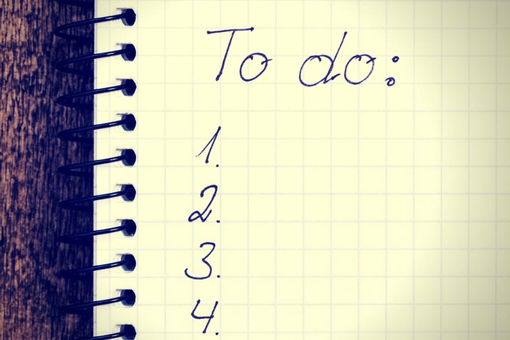 Hand written to do list on a notebook