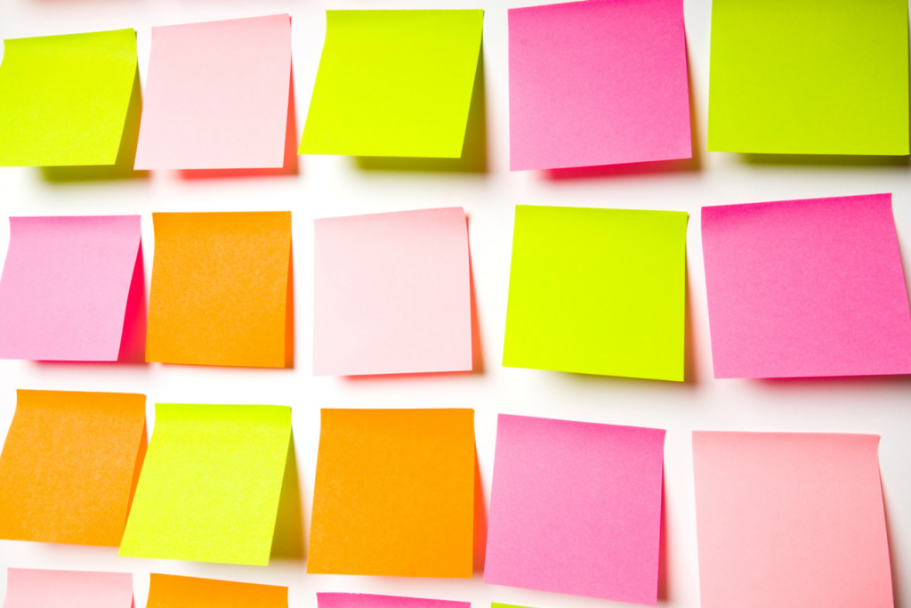Colourful post it notes on a wall