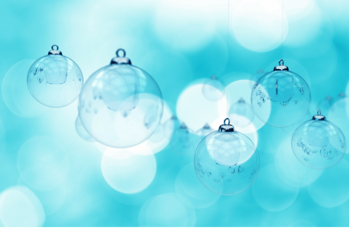 Christmas baubles on aqua background