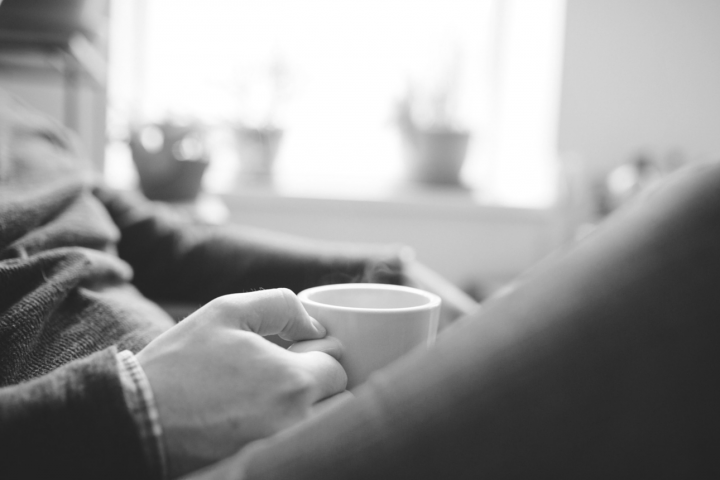 Black and white image of man drinking coffee