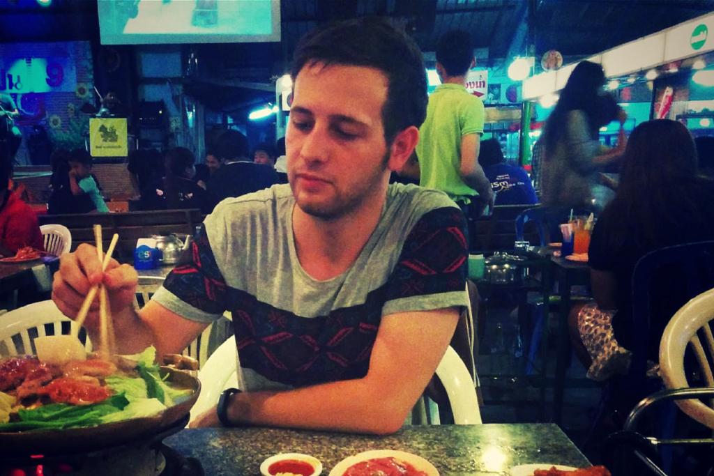 Bryce Adams eating hotpot