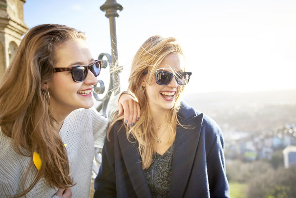 Two young women wearing Snaps sunglasses outside