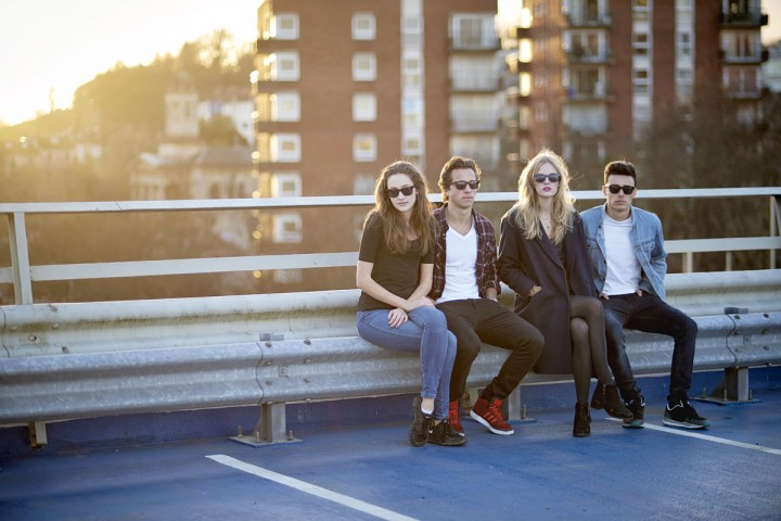 Group of 4 people wearing Snaps sunglasses on bench