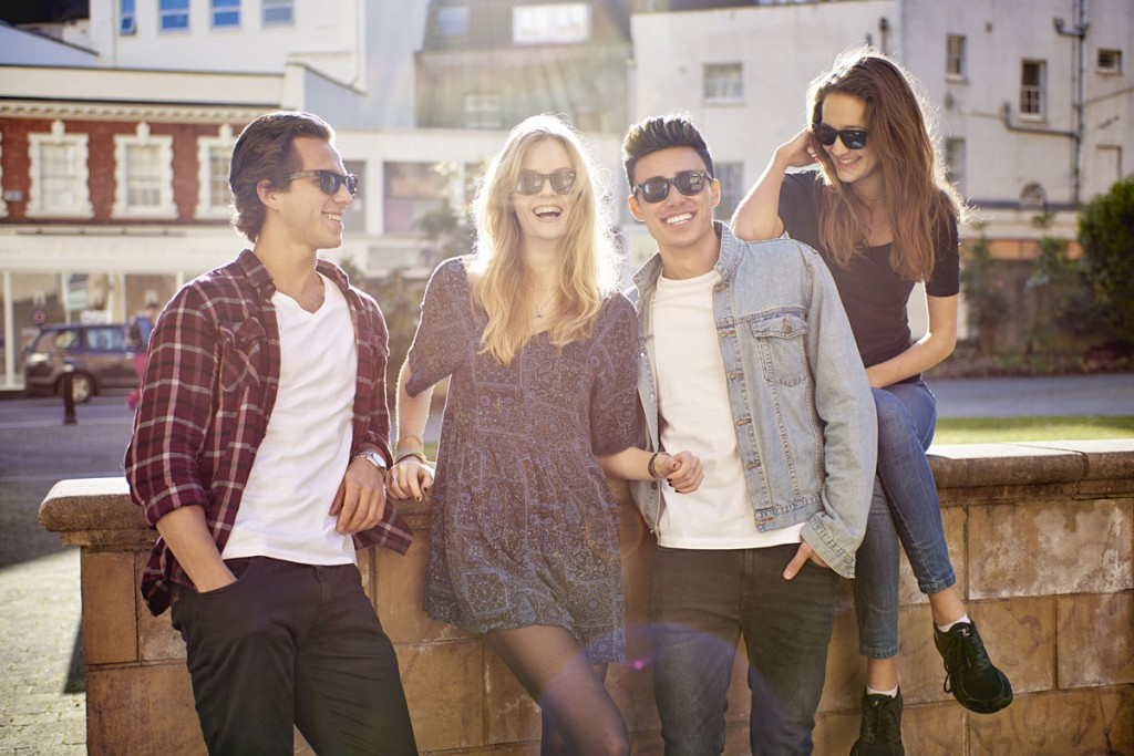 Group of 4 on Wall Smiling wearing Snaps sunglasses