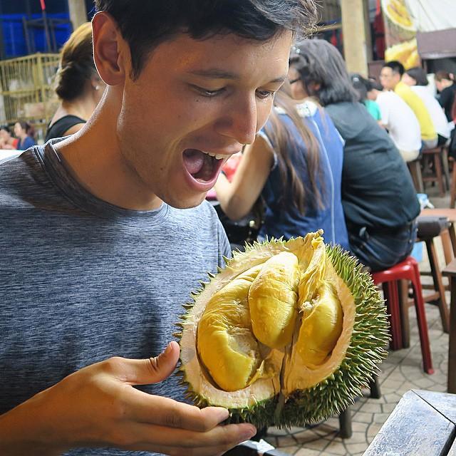 Sean Lee eating Durian