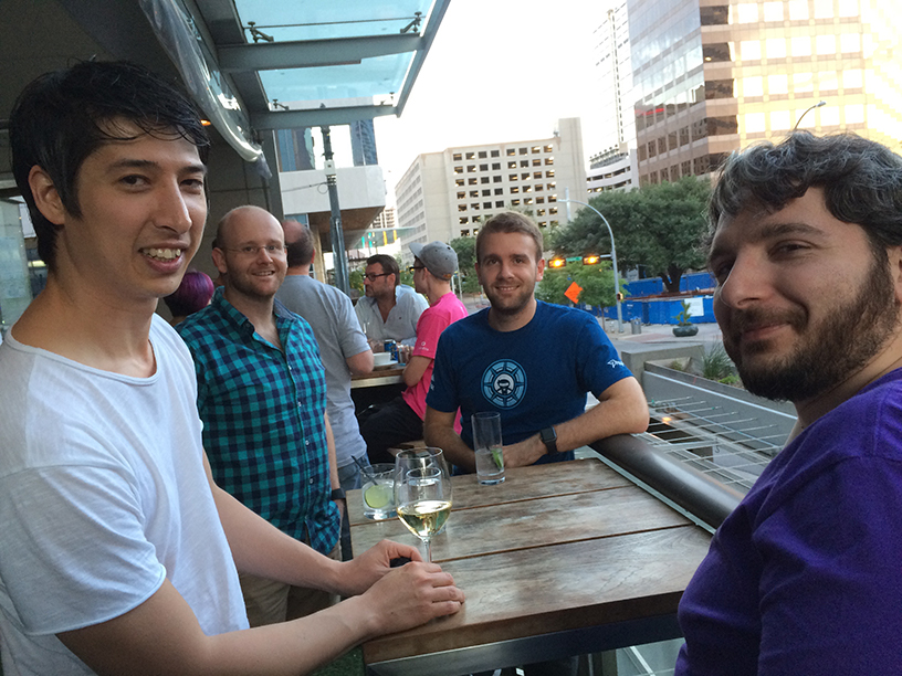 People from different teams meetup in Austin for a happy hour