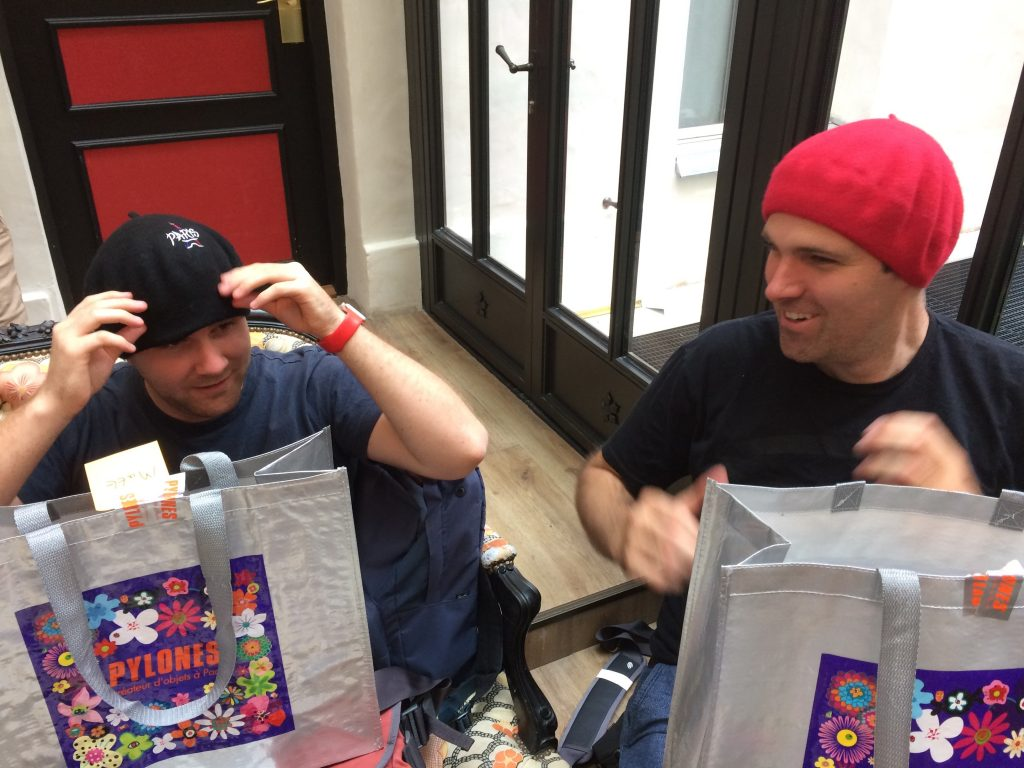Two people wearing berets and laughing