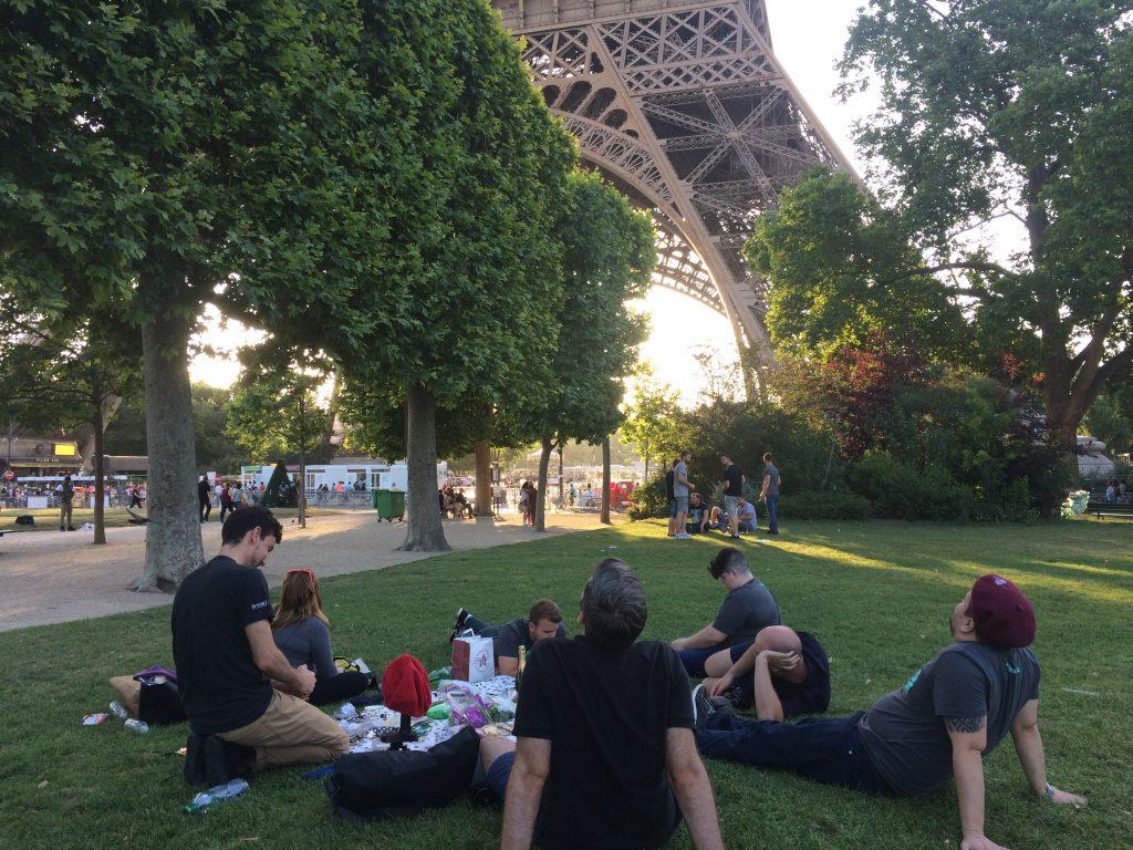 Prospress team sitting under the Eiffel Tower at Prosparis