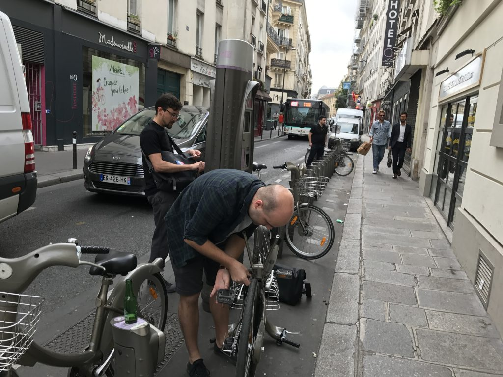 Man trying to unlock street bike in Paris