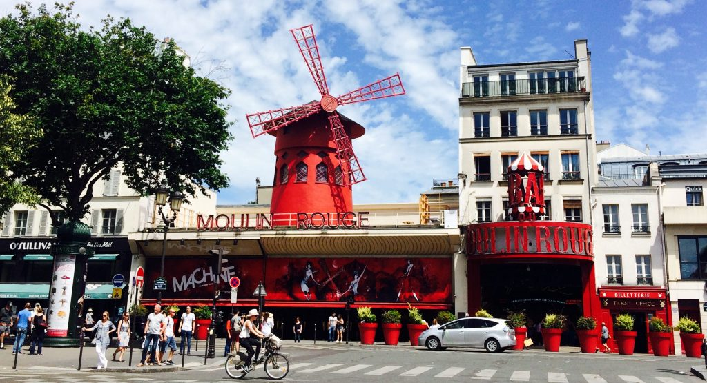 The Moulin Rouge with blue sky behind it