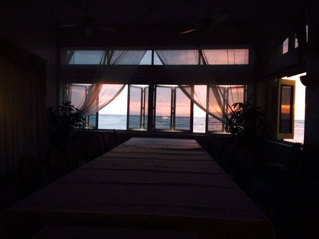 The sun setting behind conference room table