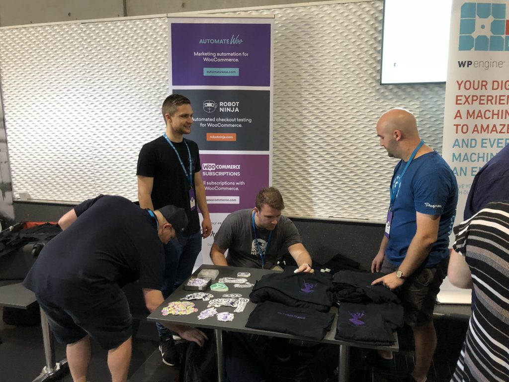 Giving out swag at WordCamp Brisbane!
