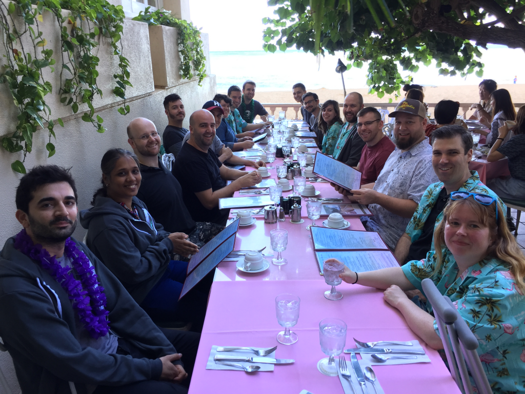 Prospress team of 18 people sitting around a breakfast table