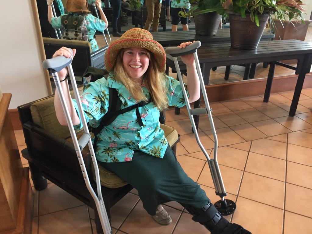 Woman sitting down holding crutches at Prosparadise