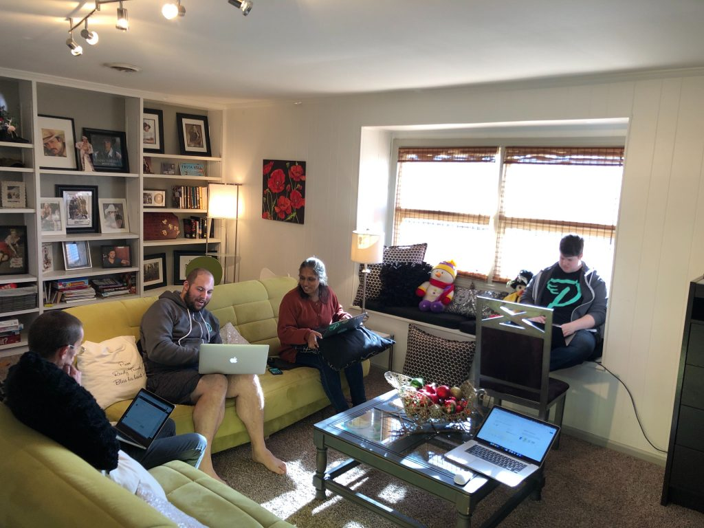 Extensions team working at house
