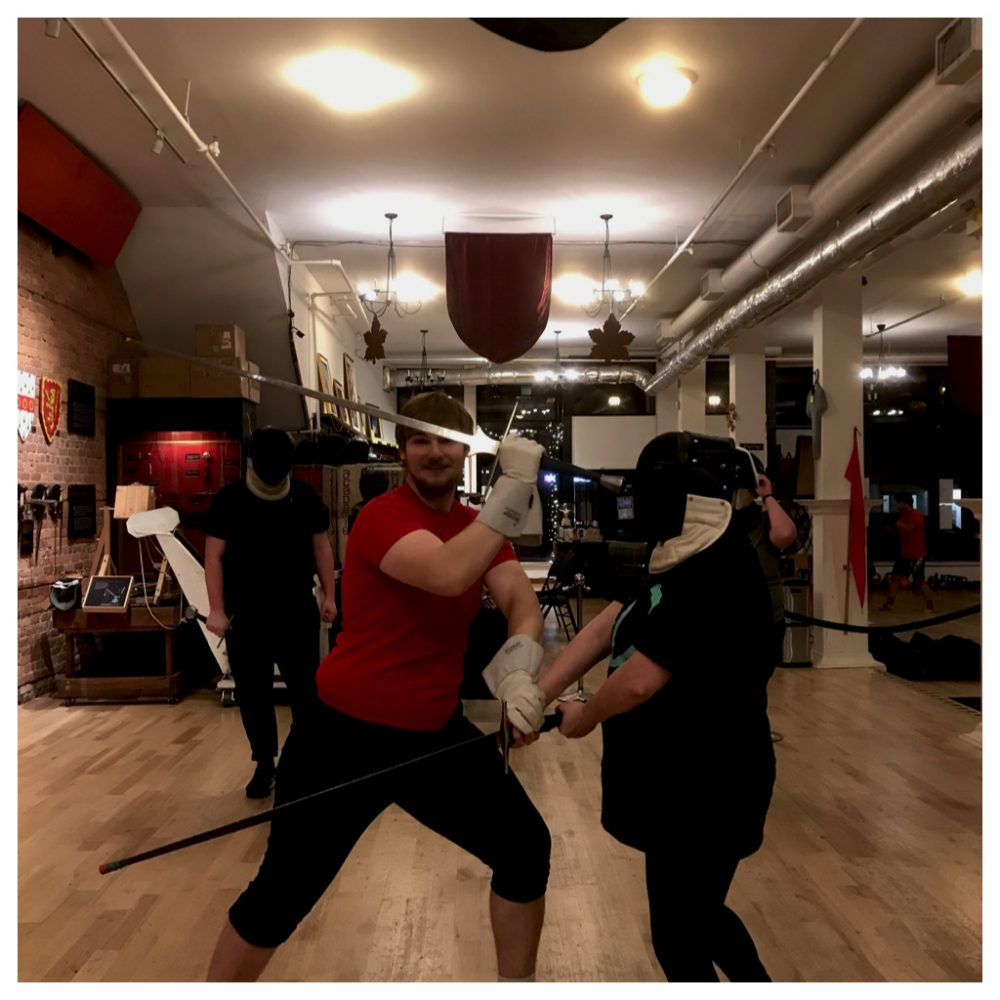 Jillian sword fighting with instructor